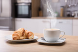 Croissant And Cup Of Coffee At Breakfast