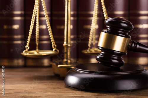 Close-up Of Gavel On Wooden Desk - 192551280