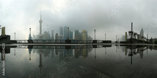 Foto op Plexiglas Shanghai view of building of Pudong in Shanghai, China, with refection on water
