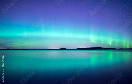 Aluminium Donkerblauw Northern lights dancing over calm lake. Farnebofjarden national park in Sweden
