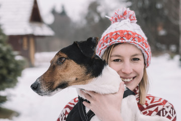 Woman embracing her dog outdoors
