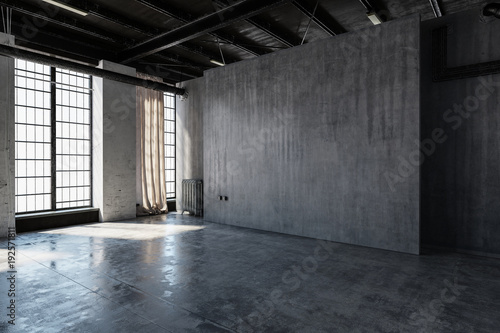 Abandoned concrete warehouse room with windows
