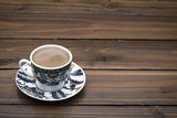 Traditional Turkish coffee over wooden floor with space for your text.