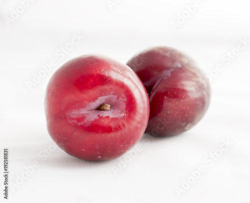 Foto Murales two plums on white background