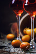 Quadro Traditional greek kumquat liqueur in shot glass, vintagen background, rustic style, selective focus
