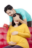 Loving husband surprises pregnant wife with present - 192594871