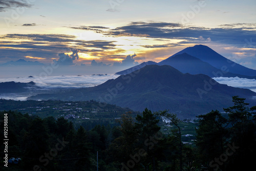 Papiers peints Noir Dawn overlooking the 3 mountains at the same time, Agun, Batur at Bali island. A small smoke from the volcano. Side view with copy space