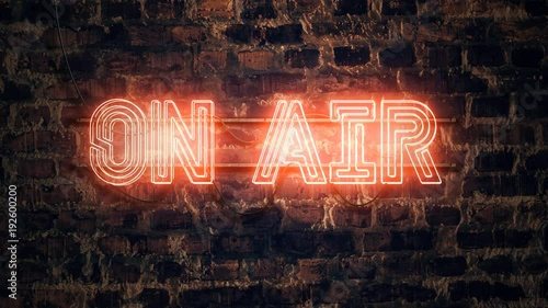 On Air neon sign mounted on rustic brick wall, animation