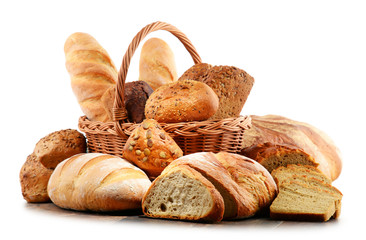 Wicker basket with assorted baking products isolated on white