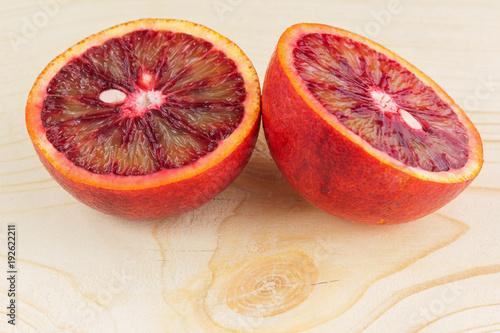 the juicy Sicilian orange cut in half on a wood