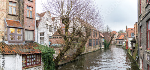 Fotobehang Brugge Scenery of water canal in Bruges in winter, cityscape of Flanders, Belgium.