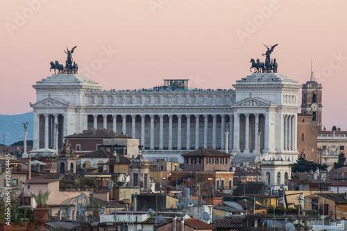 Altare della Patria in Rome, Italy, cityscape at sunset