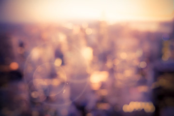 Defocused blur of buildings across New York City with sunflare effect