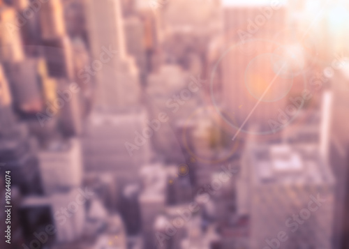 Foto Murales Defocused blur of buildings across New York City with sunflare effect