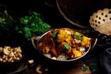pumpkin curry chicken over cashew rice. - 192655024