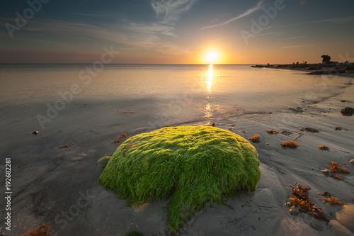 Foto Murales Sunset seascape with beautiful sky at Terongkongan Beach, Sabah Malaysia. image contain soft focus and blur due to long expose.