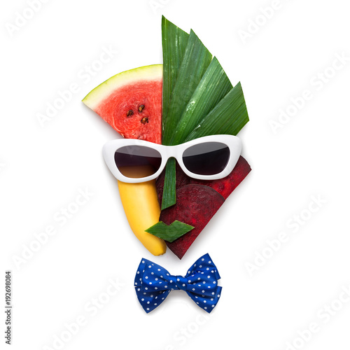 Tasty art / Creative concept of cubist style female face in sunglasses made of fruits and vegetables, on white background.