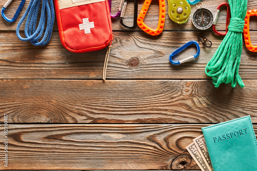 Travel items for hiking over wooden background - 192700487