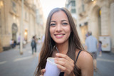 Smiling girl holding a drink