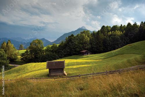 Fotobehang Donkergrijs Alpine countryside, barn in a grass field