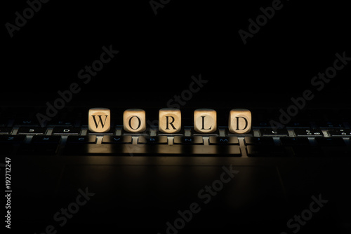Foto Murales World word on wooden cubes. World concept