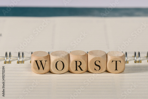Foto Murales worst word on wooden cubes. worst concept