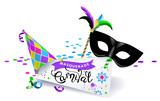 Carnival banner. Black carnival mask with colorful feathers, multicolored hat and sheet of paper with the calligraphic inscription Carnival on white background  - 192725213