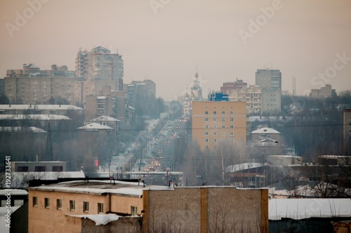 panorama of the city on a winter frosty day