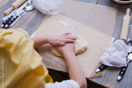Wall mural Master class for children on baking pie. Young children learn to cook a weet pie. Kids preparing homemade pie. Little cook.
