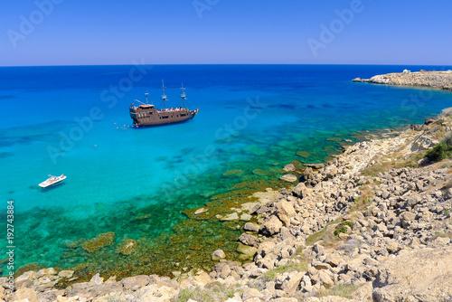 Fotobehang Cyprus Pirate ship sailing near Konnos bay on Cavo Greko peninsula, Cyprus island