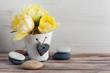 Quadro Yellow tulip flower, pebbles
