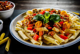 Pasta with meat, tomato sauce and vegetables - 192749460