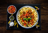 Pasta with meat, tomato sauce and vegetables - 192749474