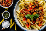Pasta with meat, tomato sauce and vegetables - 192749477