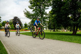 Healthy lifestyle - people riding bicycles in city park - 192749866