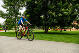 Young man biking in city park - 192749875