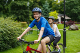 Healthy lifestyle - people riding bicycles in city park - 192750009