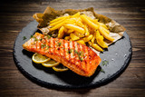 Fried salmonwith french fries on wooden table - 192750033