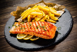 Fried salmonwith french fries on wooden table - 192750043