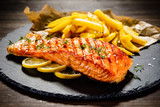 Fried salmonwith french fries on wooden table - 192750063