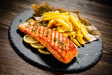 Fried salmonwith french fries on wooden table - 192750064