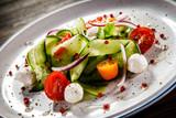 Caprese salad on wooden background - 192750202