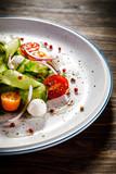 Caprese salad on wooden background - 192750210