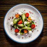 Caprese salad on wooden background - 192750223