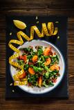 Vegetable salad on wooden background - 192750274