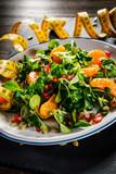 Vegetable salad on wooden background - 192750287