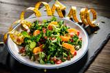 Vegetable salad on wooden background - 192750298