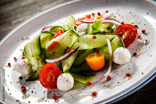 Caprese salad on wooden background - 192750202