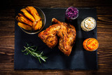 Grilled chicken legs with French fries and vegetables on wooden table - 192750658