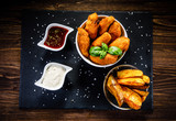 Chicken nuggets with french fries on wooden table - 192750825